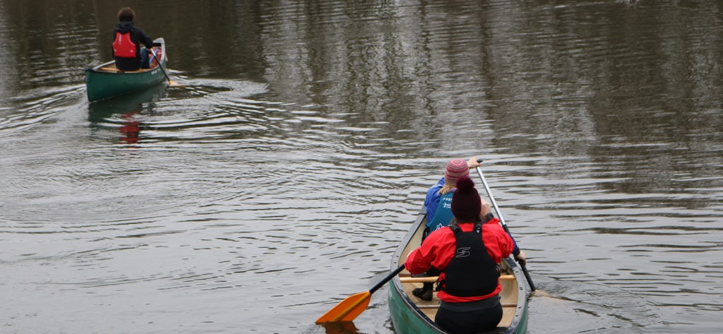 Open Canoeist Leading Other Canoeists