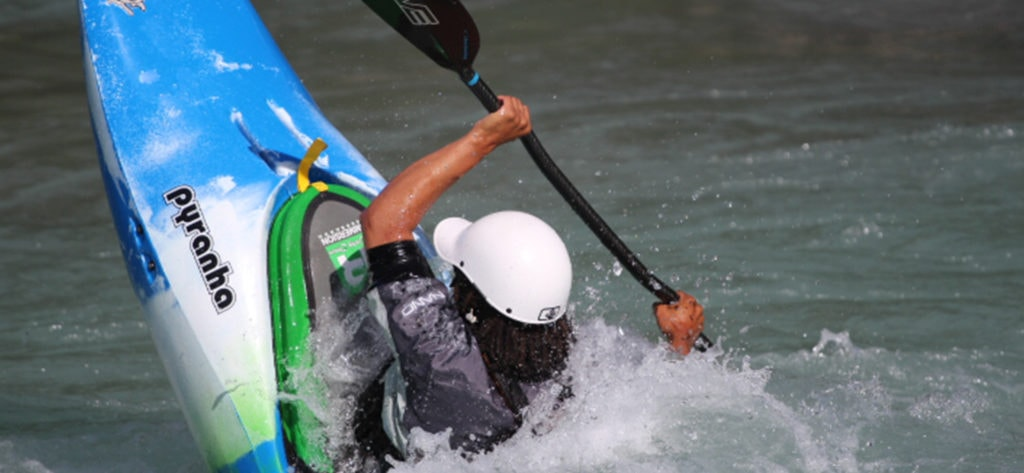 Freestyle kayaker tail squirting