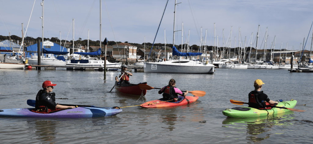 Canoe and Kayak paddlers practising in a harbour